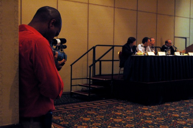 Gyimah filming the Breaking Away from Main Stream Traditions Panel